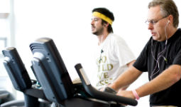 Men on cardio machines at a Vancouver community fitness centre
