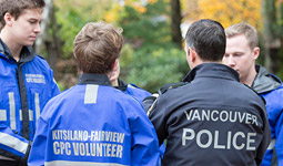 Vancouver police officer with community policing volunteers