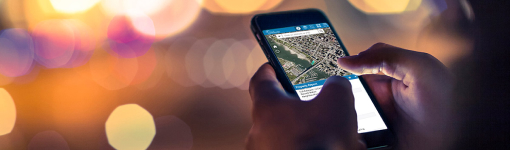 Close-up of person using VanMap on their phone